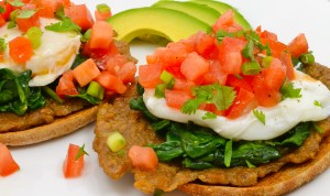 Poached Eggs on Veggie Sausage with Spinach and Tomato Cilantro Salsa